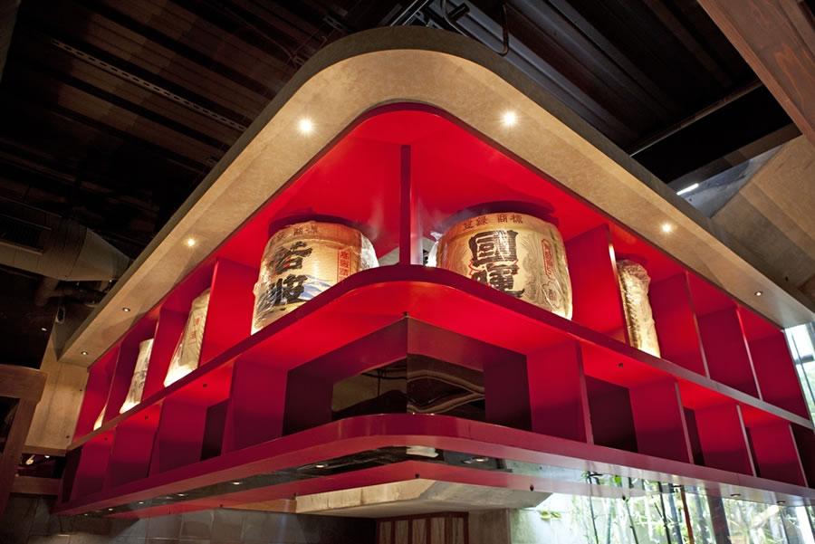 Izakaya Den red wood with sake barrels_900